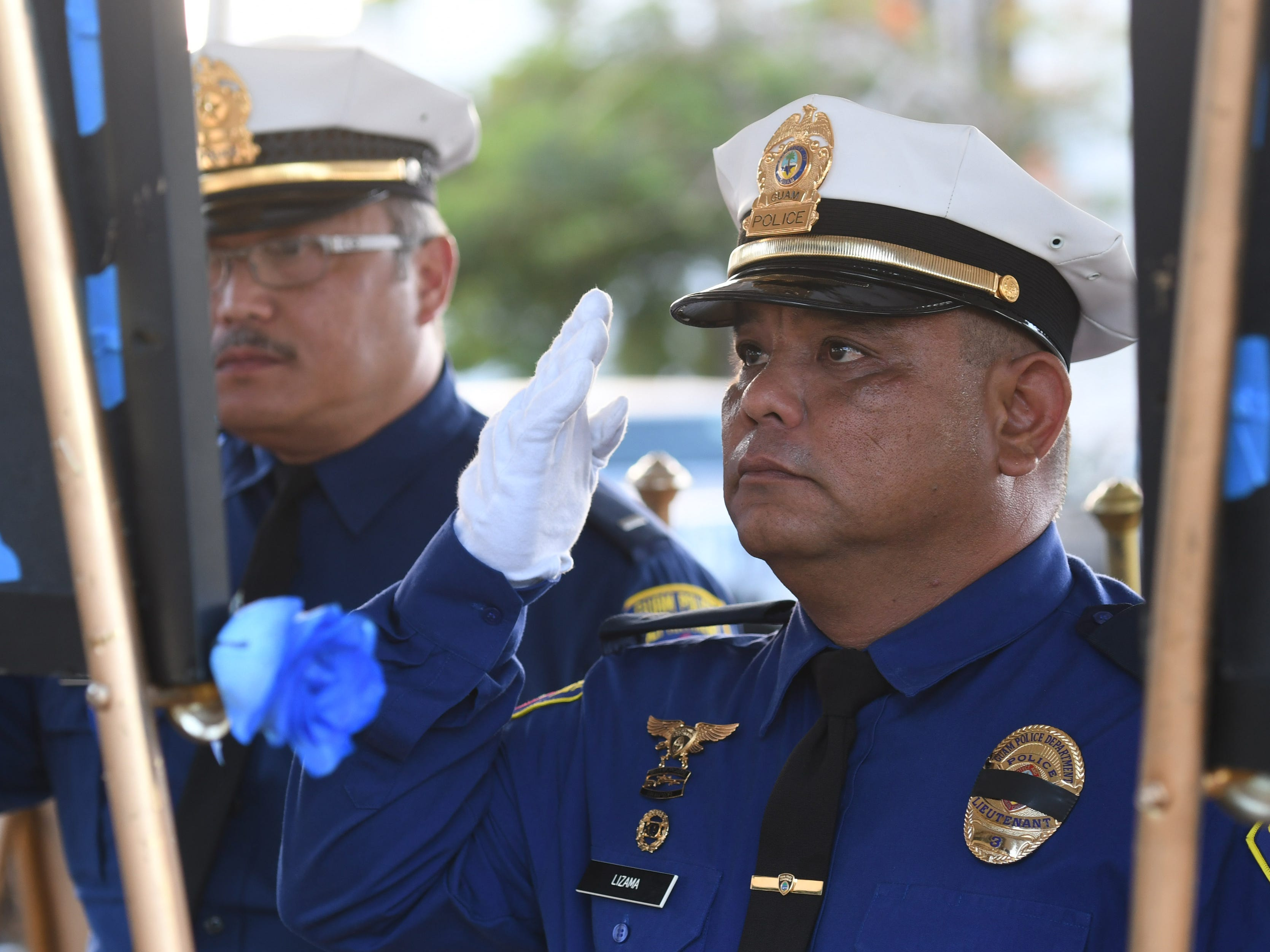 The service of Police Reserve Officer Helen Lizama is remembered during the Peace Officers' Memorial Service and Wreath Laying Ceremony held at the Guam Police Department's Badge Memorial Park in Hagåtña on Wednesday, May 15, 2019.