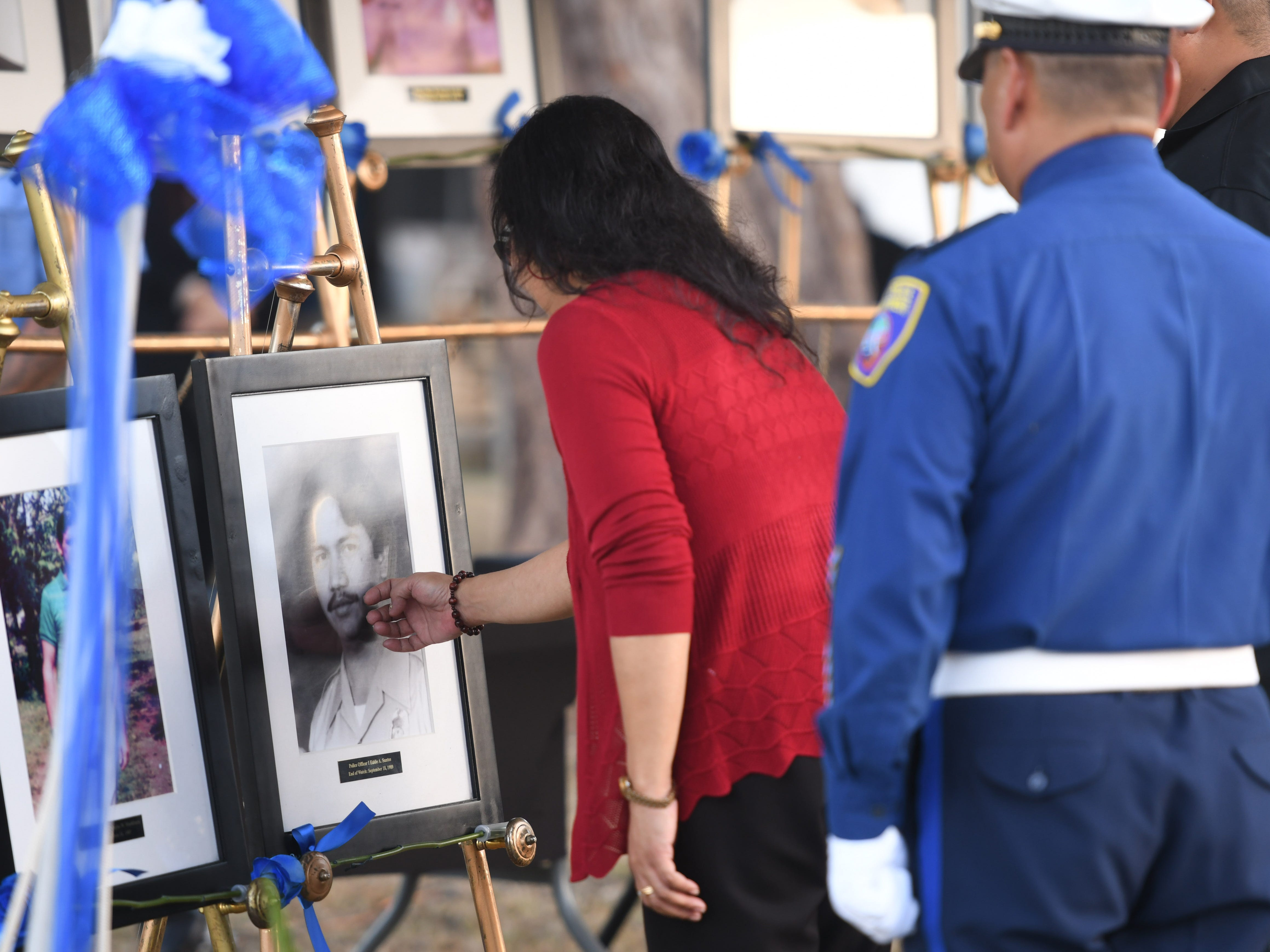 The service of Police Officer Eddie Santos is remembered during the Peace Officers' Memorial Service and Wreath Laying Ceremony held at the Guam Police Department's Badge Memorial Park in Hagåtña on Wednesday, May 15, 2019.