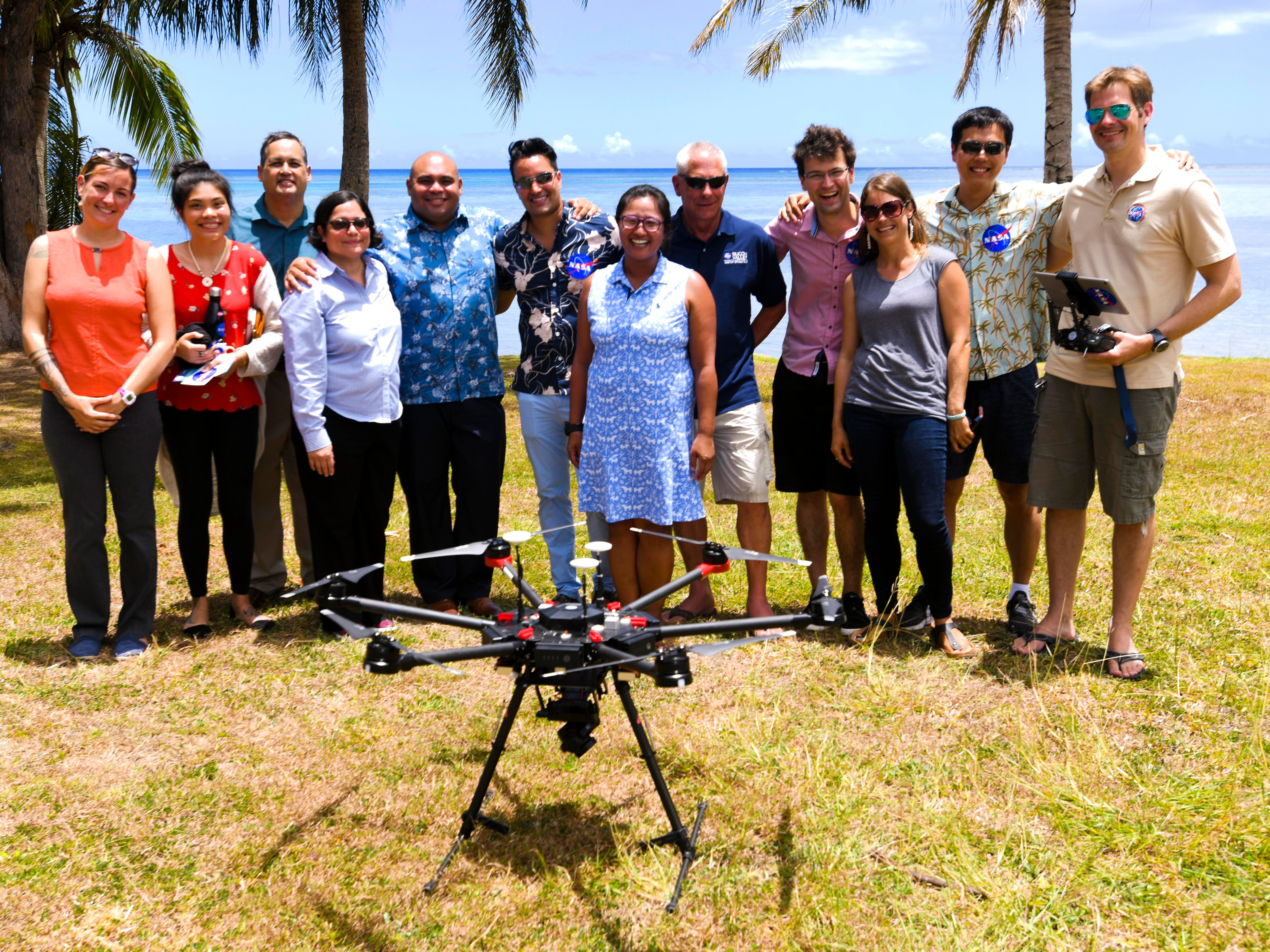 Researchers from the University of Guam's Pacific Islands Climate Adaptation Science Center and NASA's Lab for Advance Sensing Earth Science Division join Lt. Gov. Josh Tenorio and others for a photo with NASA's unmanned aerial vehicle at Tepungan Beach Park, near Fisheye Marine Park in Piti, on Wednesday, May 15, 2019. The drone, using Fluid Lensing technology developed by research scientist Ved Chirayath, has been able to map the underwater coral formations in the waters of Piti and Tumon from the air.