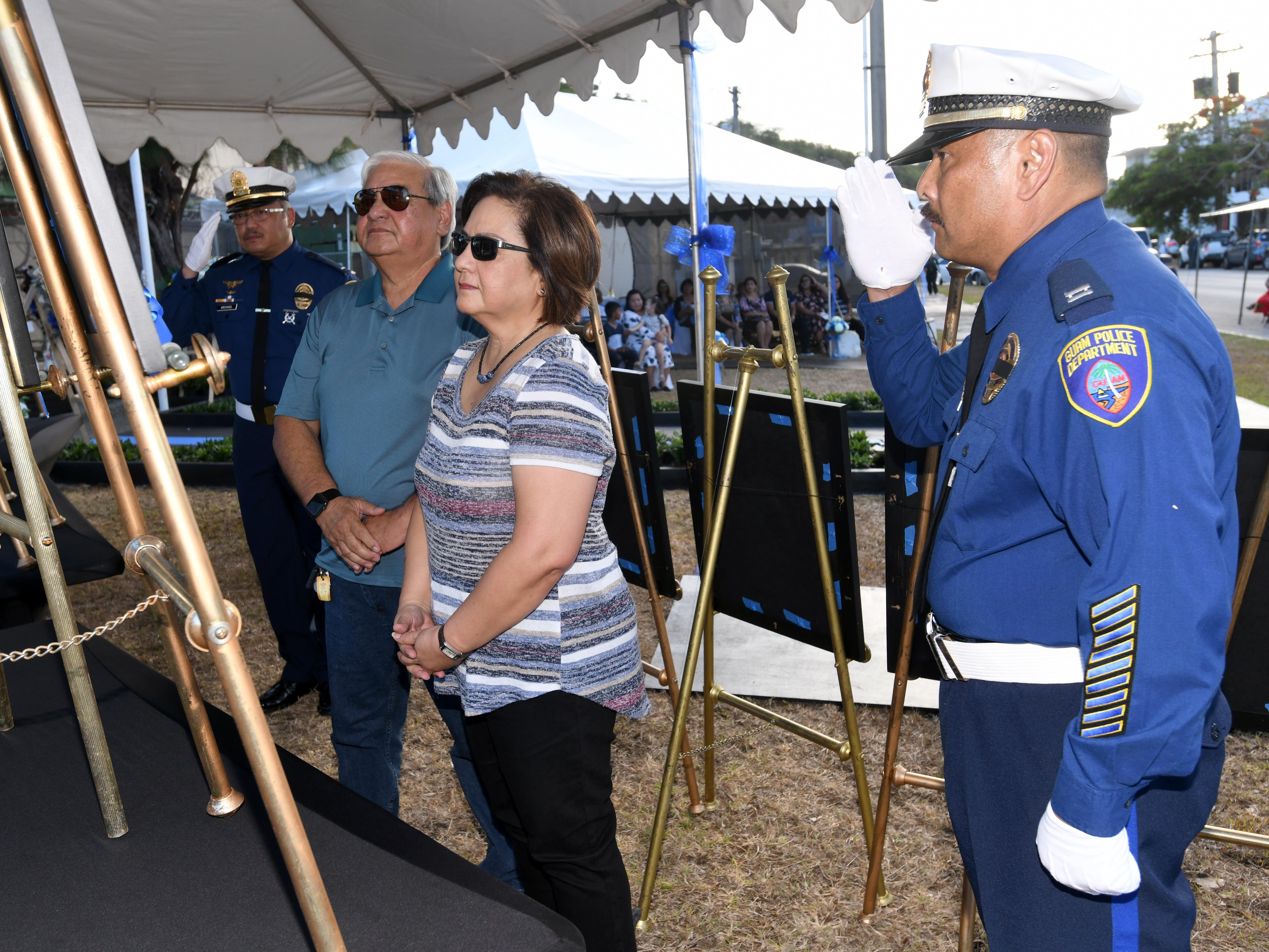 The service of Police Officer Francisco Taitague is remembered during the Peace Officers' Memorial Service and Wreath Laying Ceremony held at the Guam Police Department's Badge Memorial Park in Hagåtña on Wednesday, May 15, 2019.