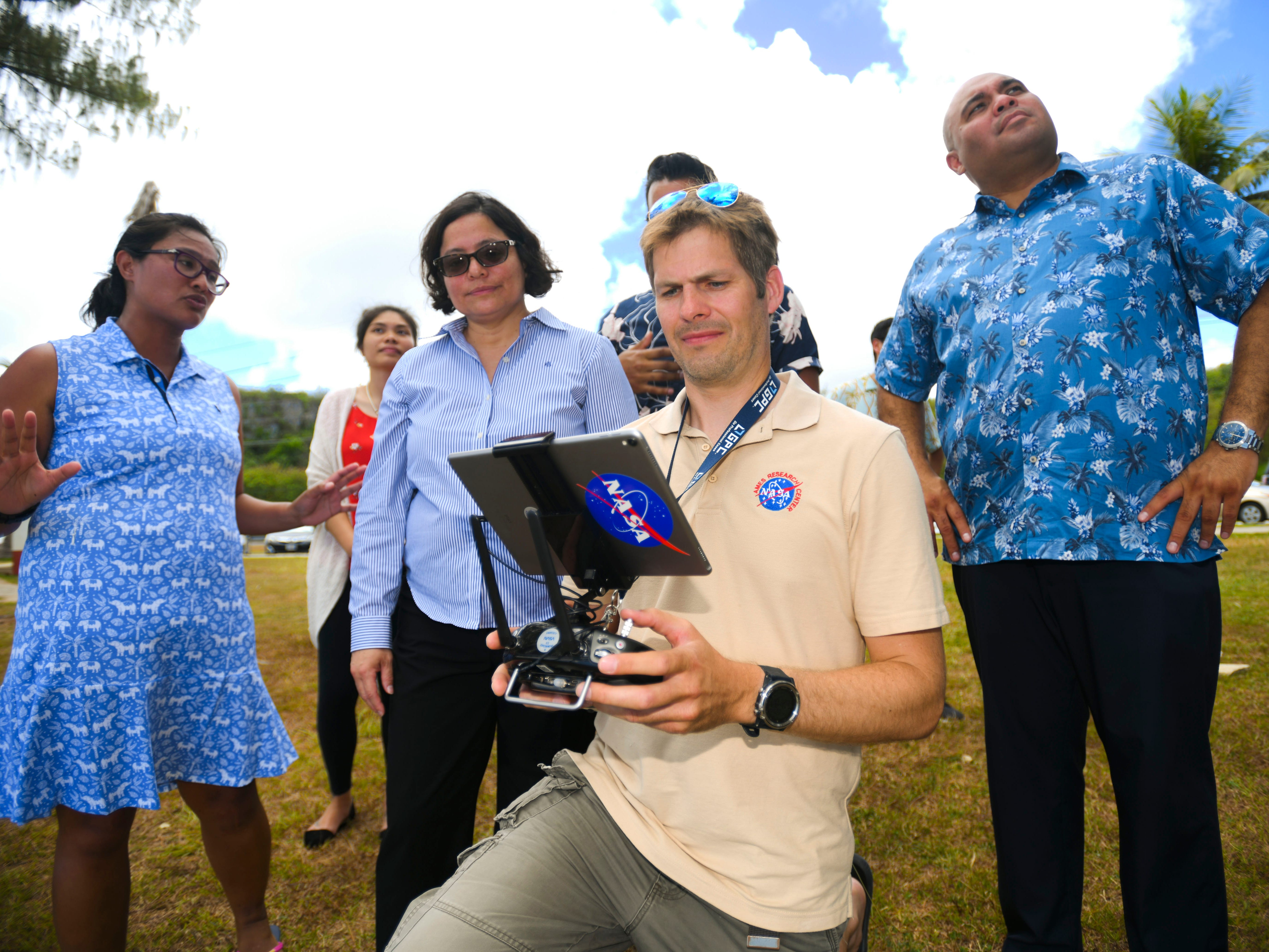 NASA research engineer Jonas Jonsson, front, controls an unmanned aerial vehicle in the sky above Tepungan Beach Park, near Fisheye Marine Park in Piti, on Wednesday, May 15, 2019. The drone, using Fluid Lensing technology, has been used to map the underwater coral reefs of Piti and Tumon, from the air.