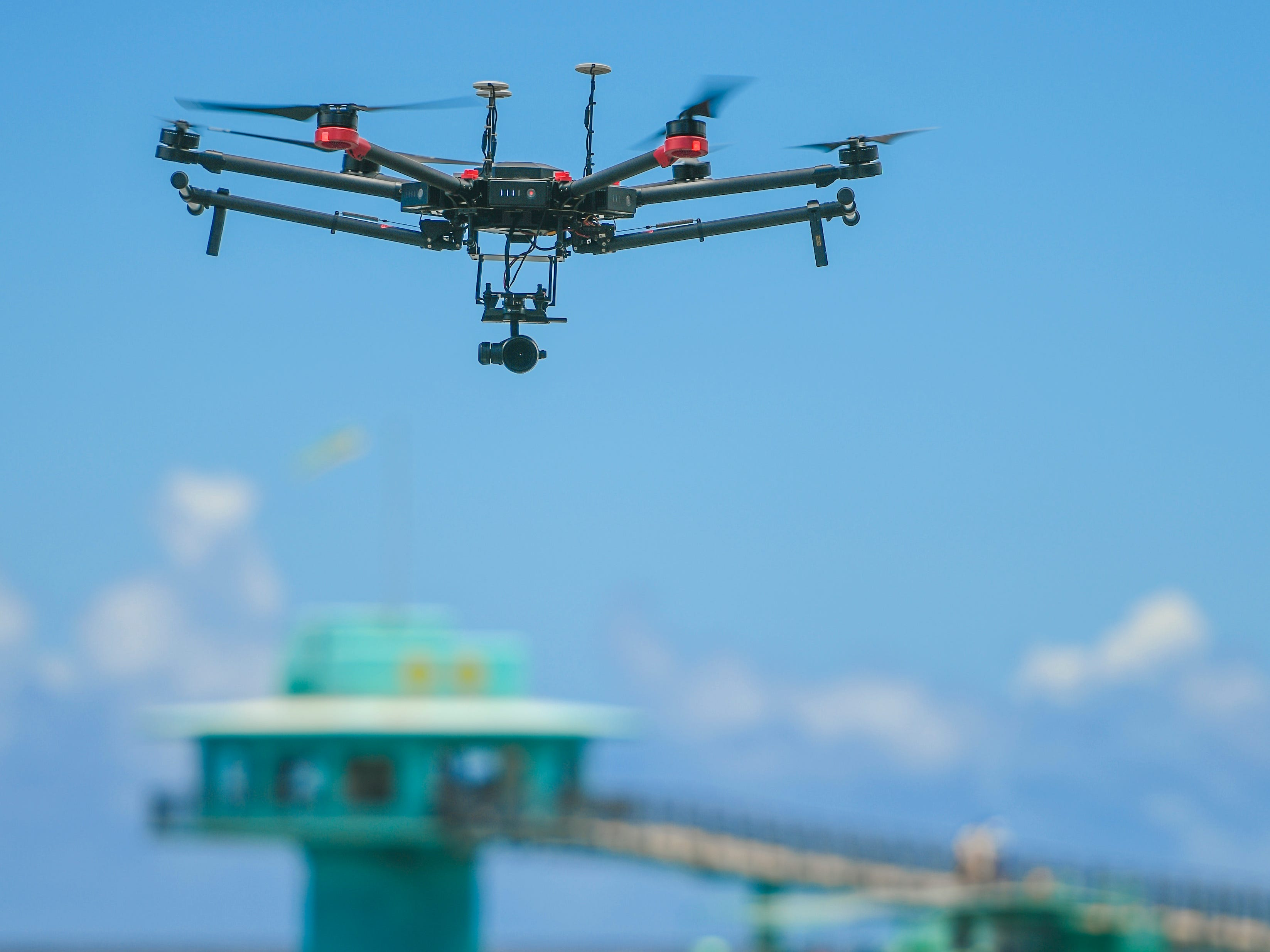 A NASA unmanned aerial vehicle hovers above the water off Tepungan Beach Park, near Fisheye Marine Park in Piti, on Wednesday, May 15, 2019. The University of Guam's Pacific Islands Climate Adaptation Science Center has been work in tandem with a scientific research team from NASA to use the drone, and Fluid Lensing technology, to map the underwater coral reef of Piti and Tumon, from the air.