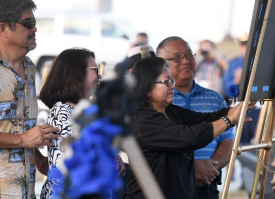 The service of Police Officer Raymond Sanchez is remembered during the Peace Officers' Memorial Service and Wreath Laying Ceremony held at the Guam Police Department's Badge Memorial Park in Hagåtña on Wednesday, May 15, 2019.