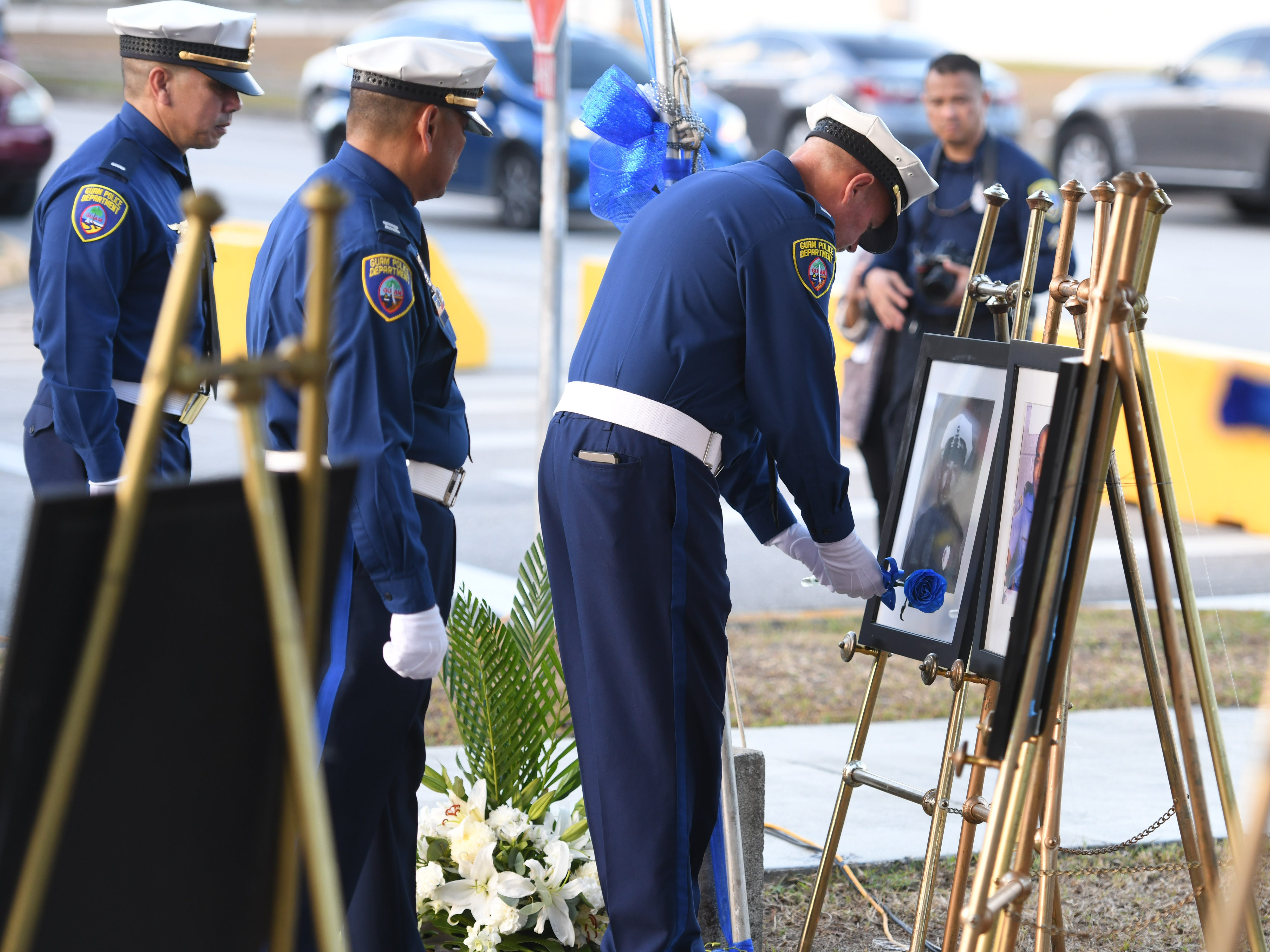 The service of Police Officer Manuel Aquino is remembered during the Peace Officers' Memorial Service and Wreath Laying Ceremony held at the Guam Police Department's Badge Memorial Park in Hagåtña on Wednesday, May 15, 2019.