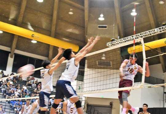 Father Duenas Friars outside hitter Aidan McDonald rips a spike down the line in the IIAAG Boys Volleyball title match against the Harvest Eagles Wednesday at the UOG Calvo Field House. The Friars won 3-0.