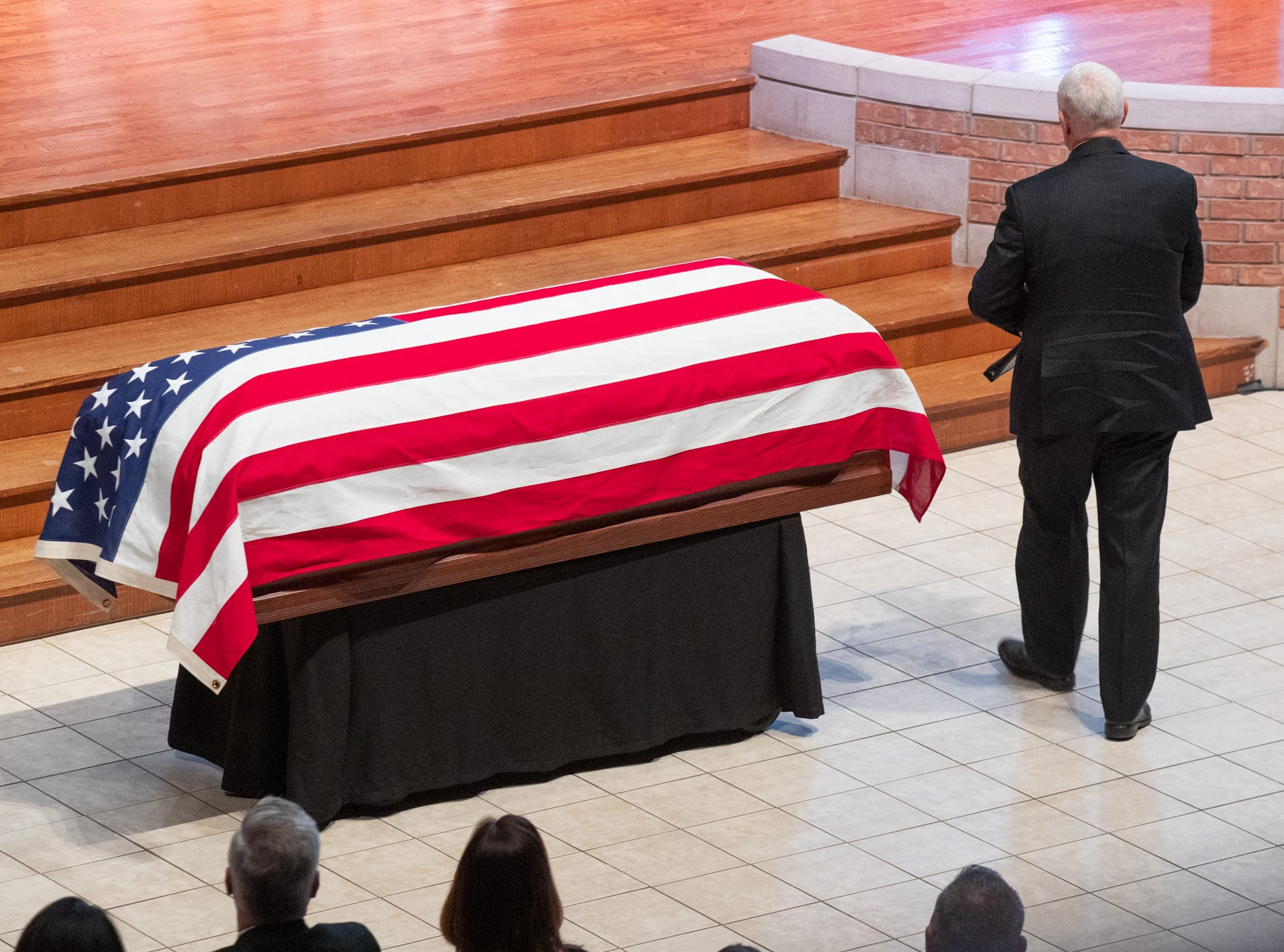 Vice President Mike Pence passes the casket of former U.S. Sen. Richard Lugar to pay tribute during a memorial service held at Saint Luke's United Methodist Church in Indianapolis, on Wednesday, May 15, 2019. Lugar served as mayor of Indianapolis from 1968 to 1975 and U.S. senator from 1977 to 2013. He died April 28, 2019, at the age of 87.