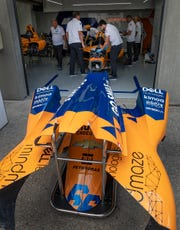 Crew members for Fernando Alonso (66) of McLaren Racing, work on building him a new car after Alonso crashed his primary car during practice for the 2019 Indianapolis 500. The team failed to qualify for the race. Now it appears the team is on the verge of making it's full-time IndyCar debut in 2020.