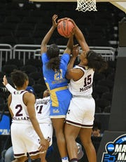 Teaira McCowan (15) figures to be a defensive force in the paint for the Fever.