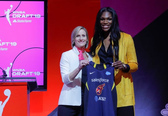 Mississippi State's Teaira McCowan, right, poses for a photo with WNBA COO Christy Hedgpeth after being selected by the Indiana Fever as the third overall pick in the WNBA draft.