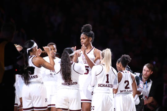 Teaira McCowan (center) helped lead Mississippi State to back-to-back national title appearances (2017-18).