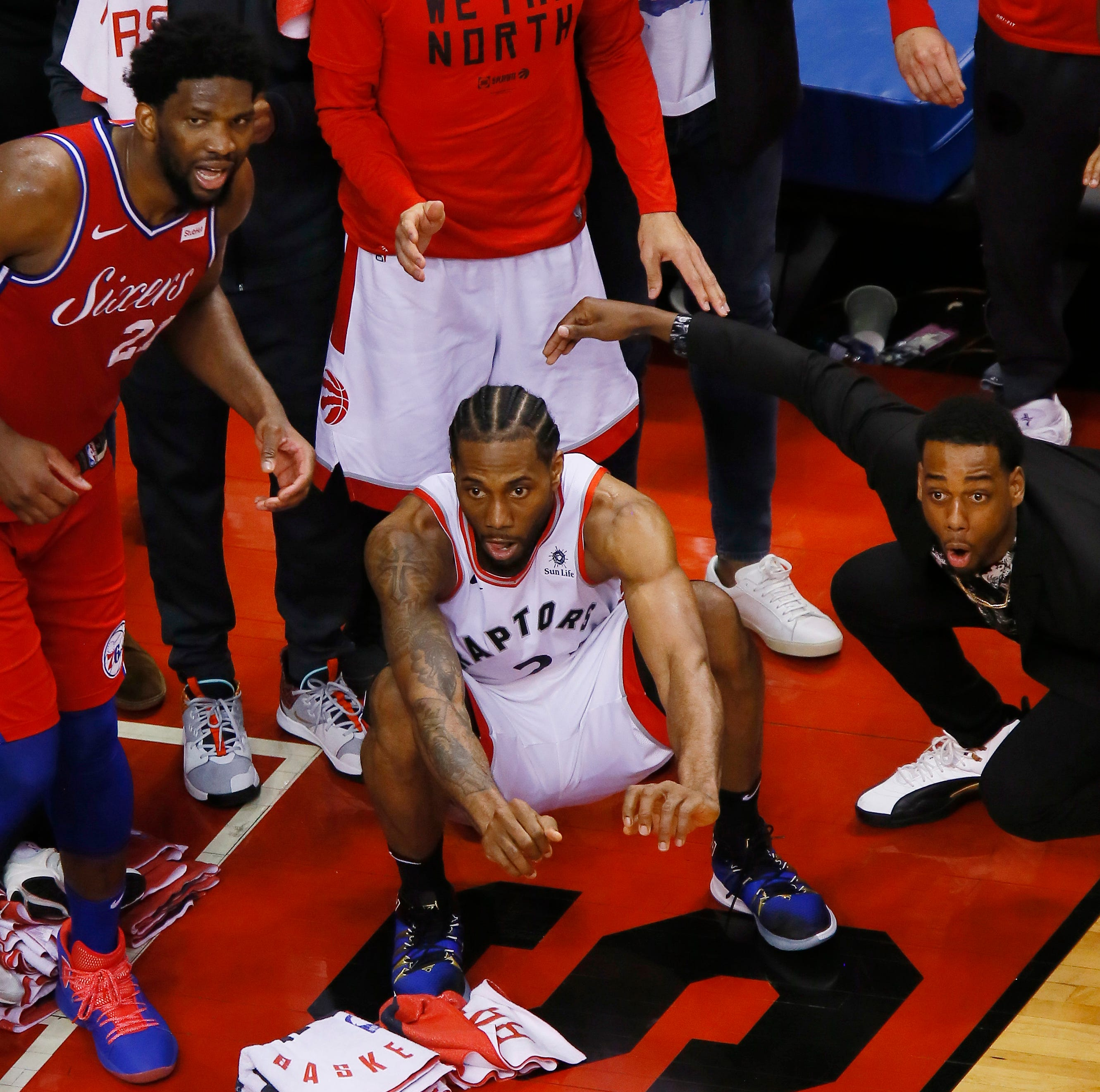 Kawhi Leonard's shot. That amazing photo. Former UIndy star Jordan Loyd is right in the thick of it
