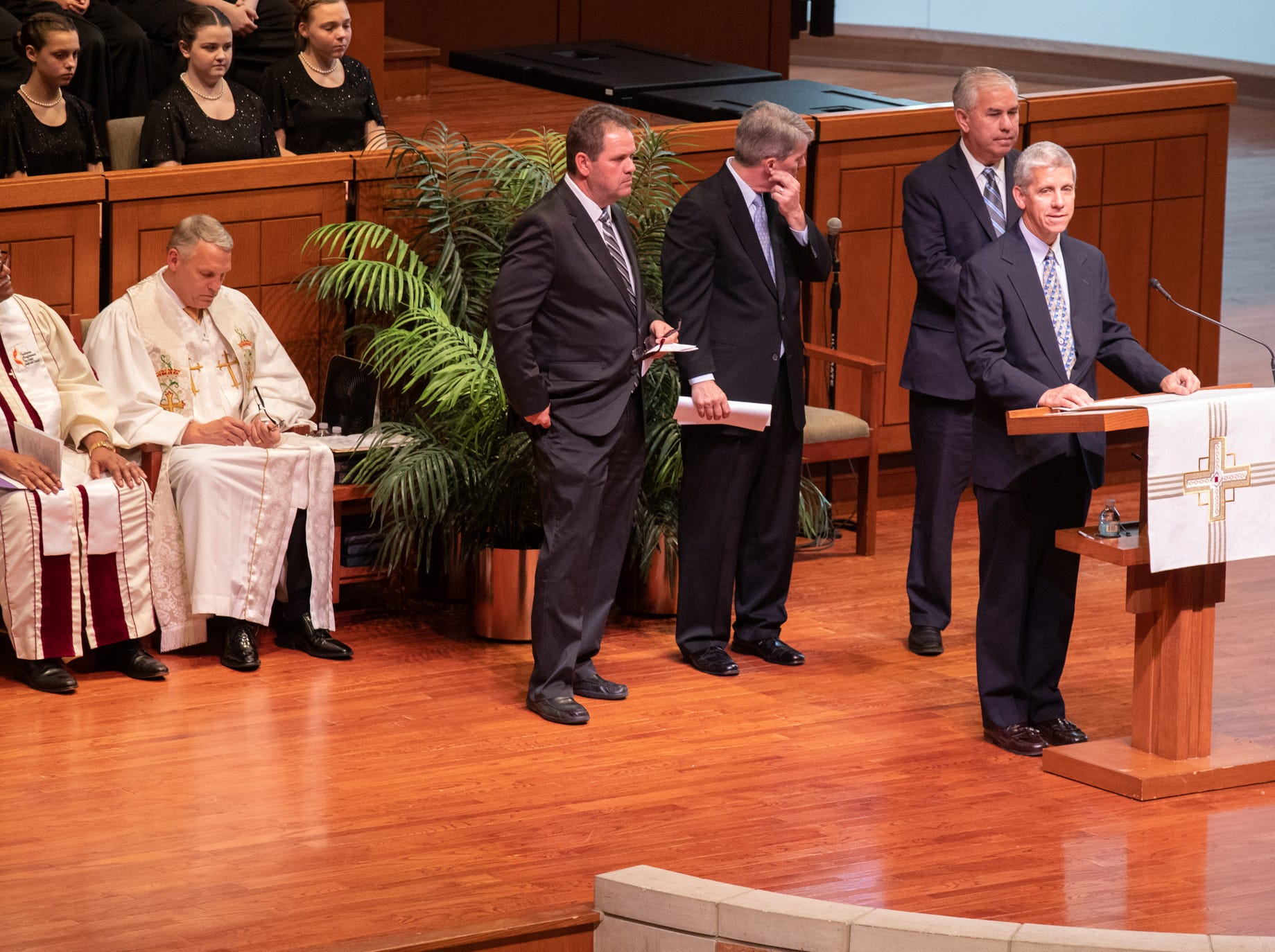 Richard Lugar's sons — John (rear, from left), David and Bob — watch as their brother Mark pays tribute to their father during a memorial service at Saint Luke's United Methodist Church in Indianapolis, on Wednesday, May 15, 2019. Lugar served as mayor of Indianapolis from 1968 to 1975 and U.S. senator from 1977 to 2013. He died April 28, 2019, at the age of 87.