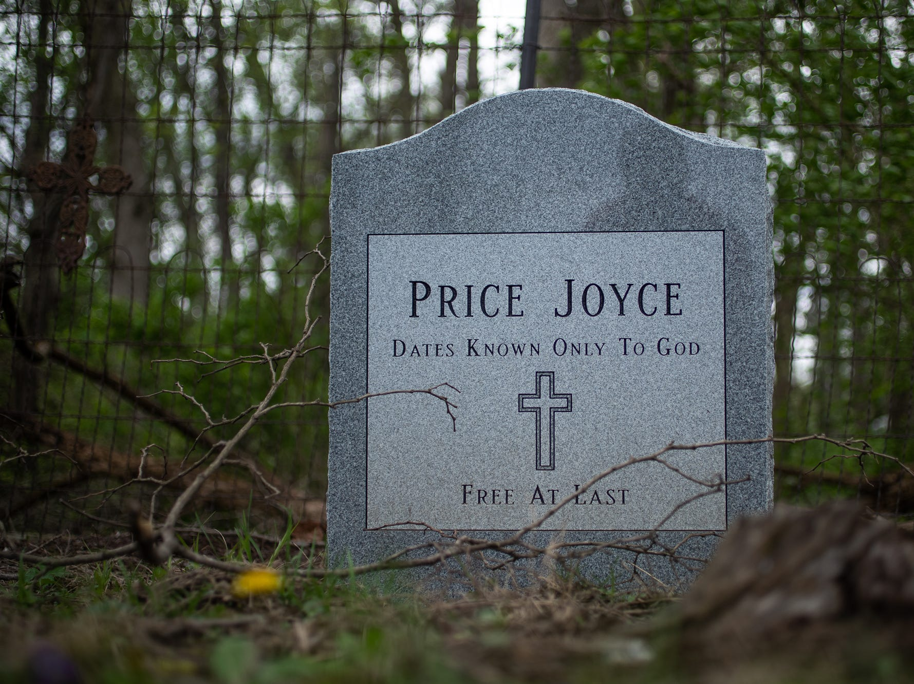 """The grave of Price Joyce sits in a small, multi-family cemetery plot, Rubush-Joyce or Sampson Cemetery, in southern Marion county on Wednesday, May 1, 2019. The grave of Joyce, a slave brought from Patrick County, Virginia to Indiana by Alexander Joyce in the 1830s, was unmarked until Joyce's great-great-great-grandson, Jeff Purvis, placed a head stone. """"I would like to believe the old family stories that he freed Price before leaving Virginia,"""" said Purvis. """"But I see no compelling evidence to support that."""""""