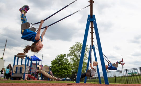 Pre-kindergarten students swing during outside play at IU Health Day Early Learning Center in Indianapolis on Tuesday, May 14, 2019.