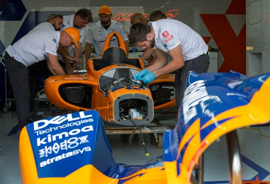 Crew members for Fernando Alonso (66) of McLaren Racing, work on building him a new car after Alonso crashed his primary car during practice for the Indianapolis 500 at the Indianapolis Motor Speedway on Wednesday, May 15, 2019.