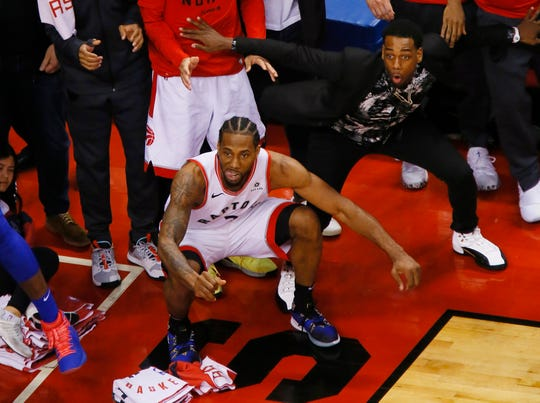 Former UIndy player Jordan Loyd looks on as Raptors forward Kawhi Leonard watches his game winning basket go in against the Philadelphia 76ers during game seven of the second round of the 2019 NBA Playoffs.