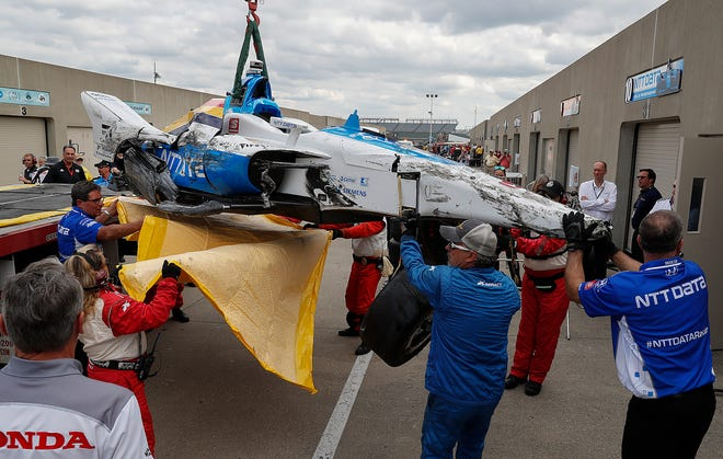 IndyCar Safety crew and members of the Felix Rosenqvist (10) of Chip Ganassi Racing team unload the wrecked car of Rosenqvist after he crashed into turn 2 during practice for the Indianapolis 500 at the Indianapolis Motor Speedway on Wednesday, May 15, 2019.