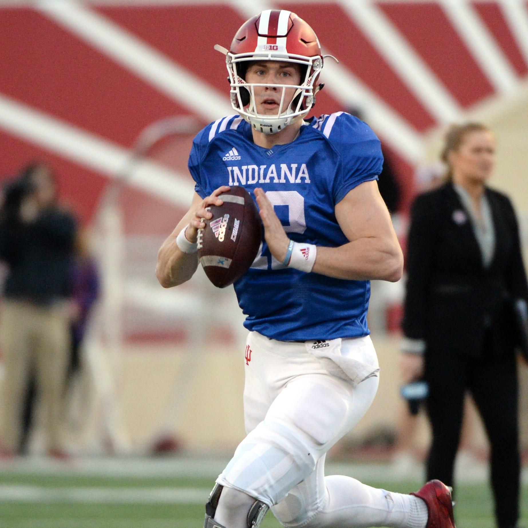 Indiana quarterback Peyton Ramsey (12) runs with...