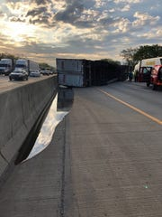 "A semi hauling containers of ""Amber Honey"" lost control and rolled over."