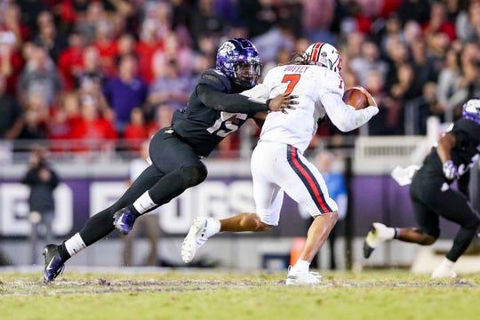 TCU defensive end Ben Banogu (15) tracks down Texas Tech quarterback Jett Duffey (7) on October 11, 2018 at Amon G. Carter Stadium in Fort Worth.