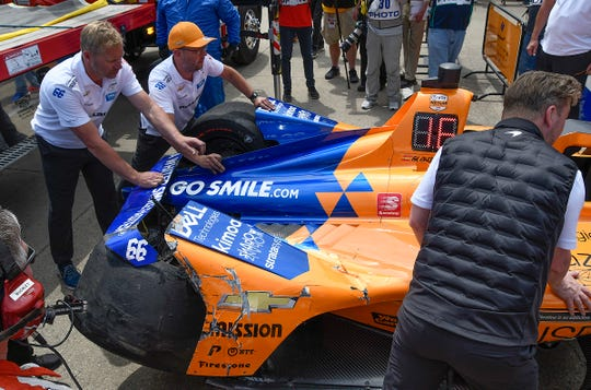 The IndyCar of McLaren Racing's Fernando Alonso is unloaded in the garage area after he crashed betweens turns 3 & 4 during practice for the Indianapolis 500 at the Indianapolis Motor Speedway on Wednesday, May 15, 2019.
