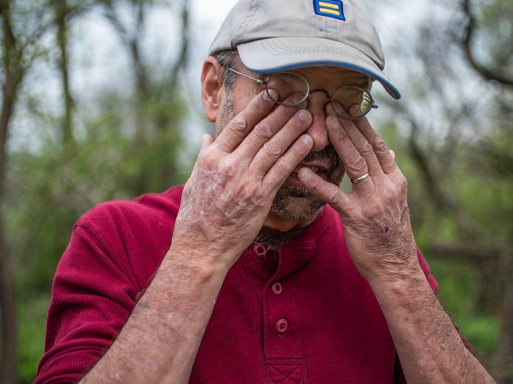 """Jeff Purvis wipes tears from his face as he talks about the gravesite of a slave his ancestor brought to Indiana in the 1830s. Purvis says the old family tale suggests the slave, Price Joyce, was being freed but his research suggests differently.  """"I think it's curious he only had one slave when some of his siblings had numerous ones,"""" said Purvis, of his great-great-great-grandfather, Alexander Joyce, on Wednesday, May 1, 2019. """"And in these wills, they split families up. A wife goes this way. A husband goes this way. Kids go a third way. It's remarkable but remarkably awful."""""""