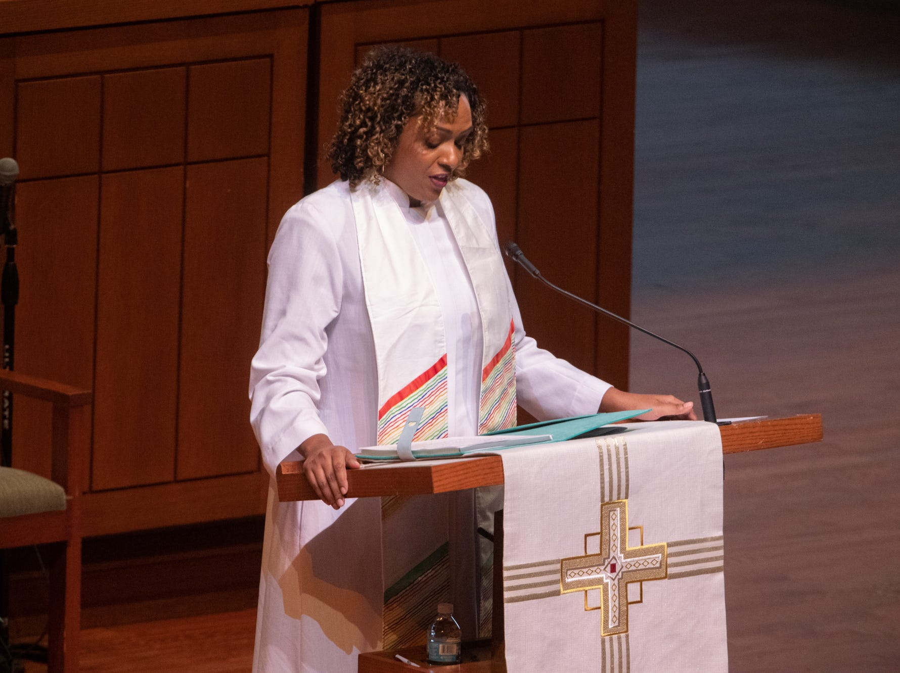 Rev. Nicole Caldwell-Gross, Saint Luke's United Methodist Church Pastor of Outreach, reads a prayer during former U.S. Sen. Richard Lugar's memorial service, held at Saint Luke's United Methodist Church in Indianapolis, on Wednesday, May 15, 2019. Lugar served as mayor of Indianapolis from 1968 to 1975 and U.S. senator from 1977 to 2013. He died April 28, 2019, at the age of 87.