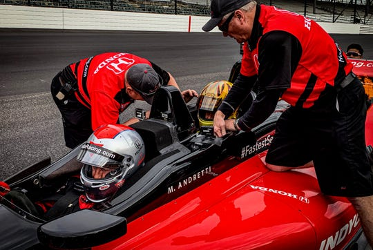 Reigning NHRA Funny Car champion J.R. Todd hops in the back of a two-seater Indy car with Mario Andretti. (Photo provided: Luke Fath, Kalitta Motorsports)