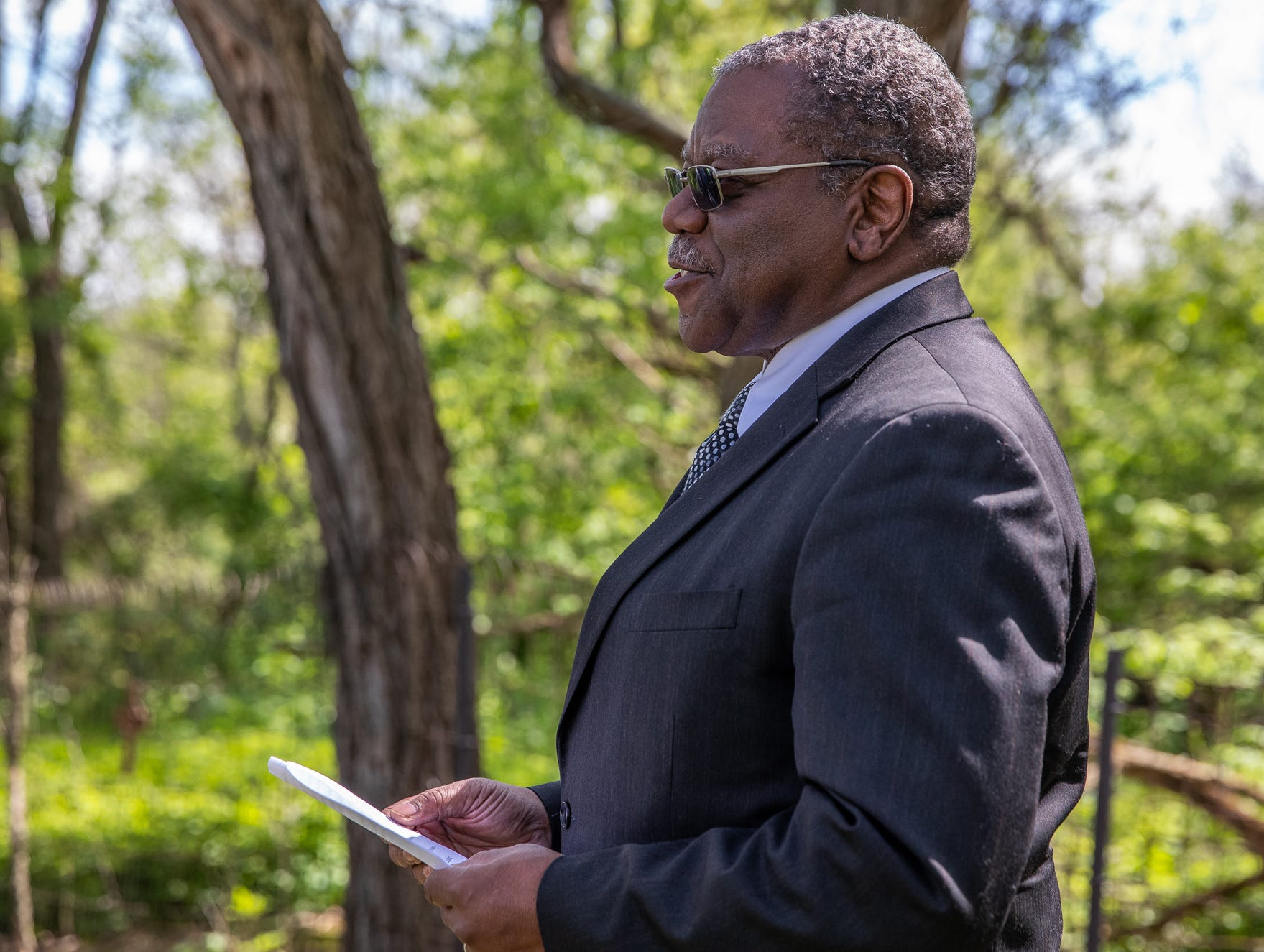 """Pastor James Foster speaks during a small ceremony for former slave Price Joyce on Saturday, May 11, 2019. """"Jeff, thank you for your great sensitivity,"""" said Foster, to Jeff Purvis, great-great-great-grandson of Alexander Joyce II, Price's previous owner who brought him to Indiana from Virginia. """"You gave me the honor to preside over this special event after the thought came to you that Price would appreciate, maybe, a familiar face."""""""