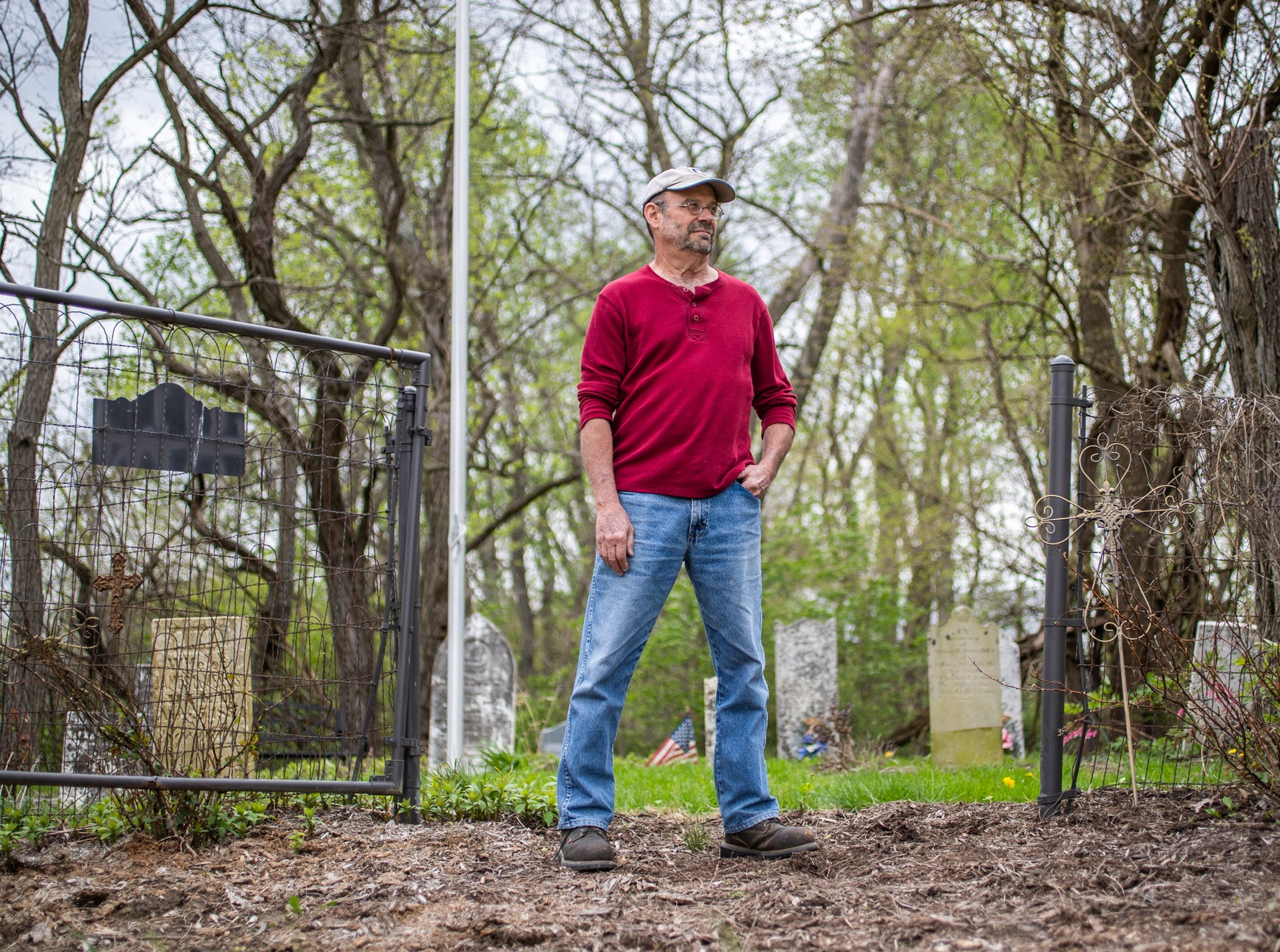 """Jeff Purvis stands in front of his family's gravesite in southern Marion county on Wednesday, May 1, 2019. The land where the gravesite sits was settled by Pruvis' great-great-great-grandfather, Alexander Joyce, in the late 1830s. When he settled, Joyce brought a slave, Price Joyce, with him from Patrick County, Virginia. The grave of Price was unmarked until Purvis placed a stone where he believes Price's body lays. """"I didn't enslave this man,"""" said Purvis, wiping away tears. """"But I do have it in my power to apologize. And my God, I'm sorry. Too little, too late."""""""