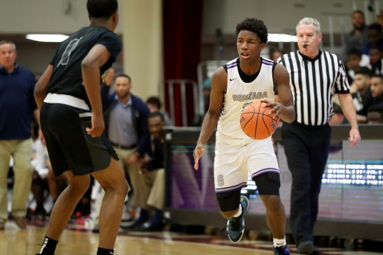 Gonzaga's Chuck Harris (right) committed to Butler.