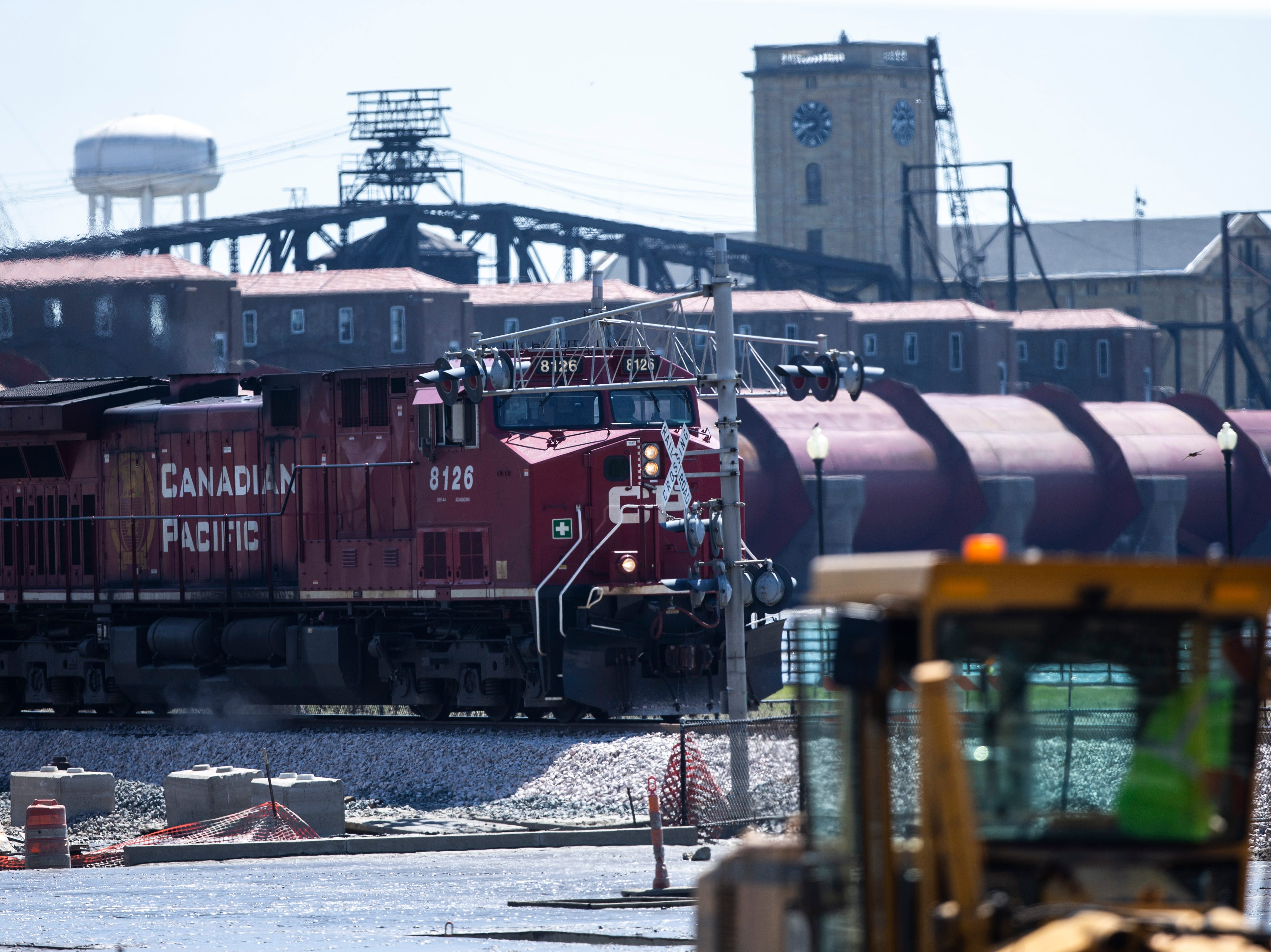 A Canadian Pacific train engine drives along the tracks as cleanup begins after floodwaters receded, Wednesday, May 15, 2019, in downtown Davenport, Iowa.
