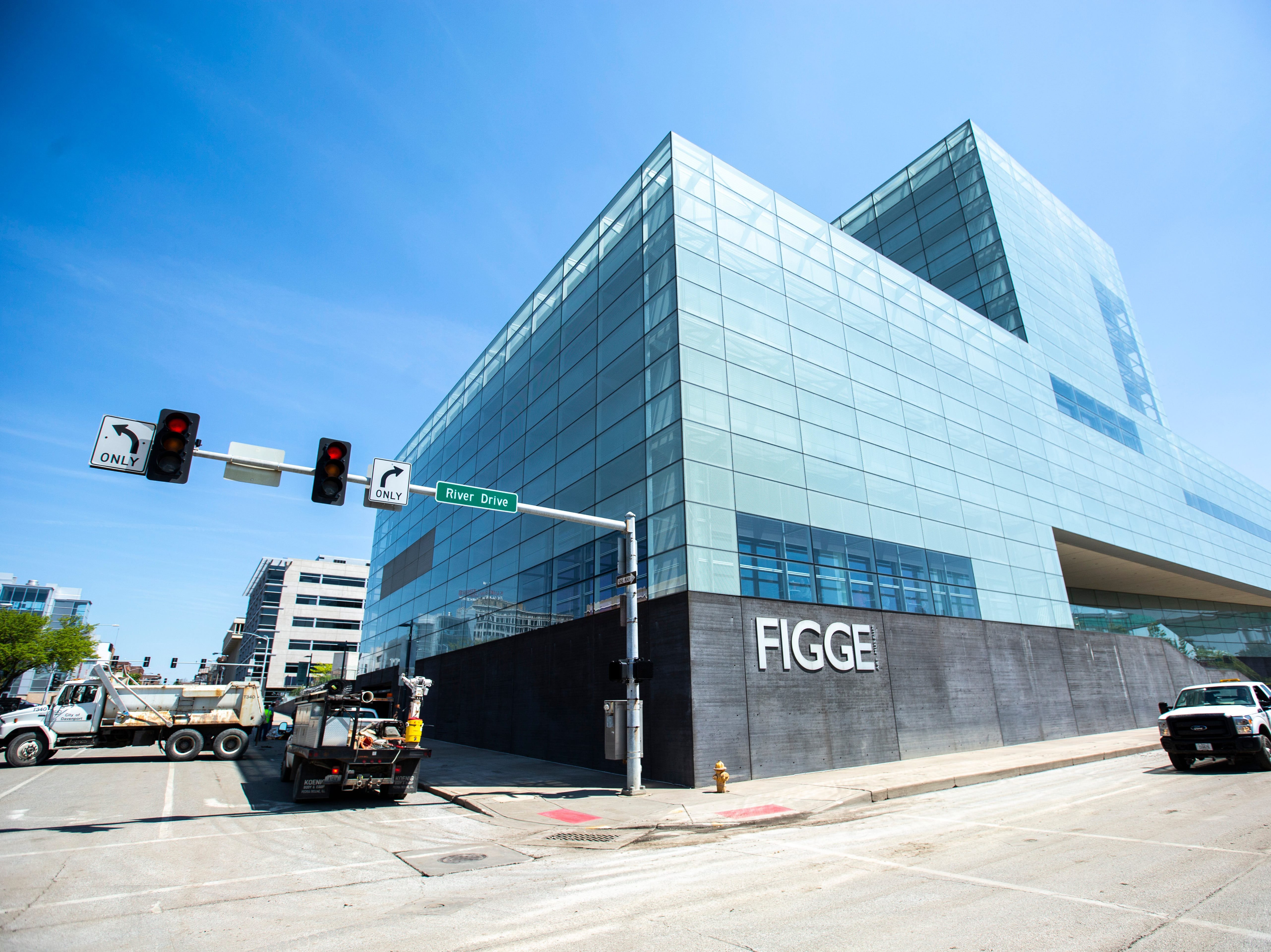 A City of Davenport vehicle drives past the Figge Art Museum as cleanup begins after floodwaters receded, Wednesday, May 15, 2019, along River Drive in downtown Davenport, Iowa.