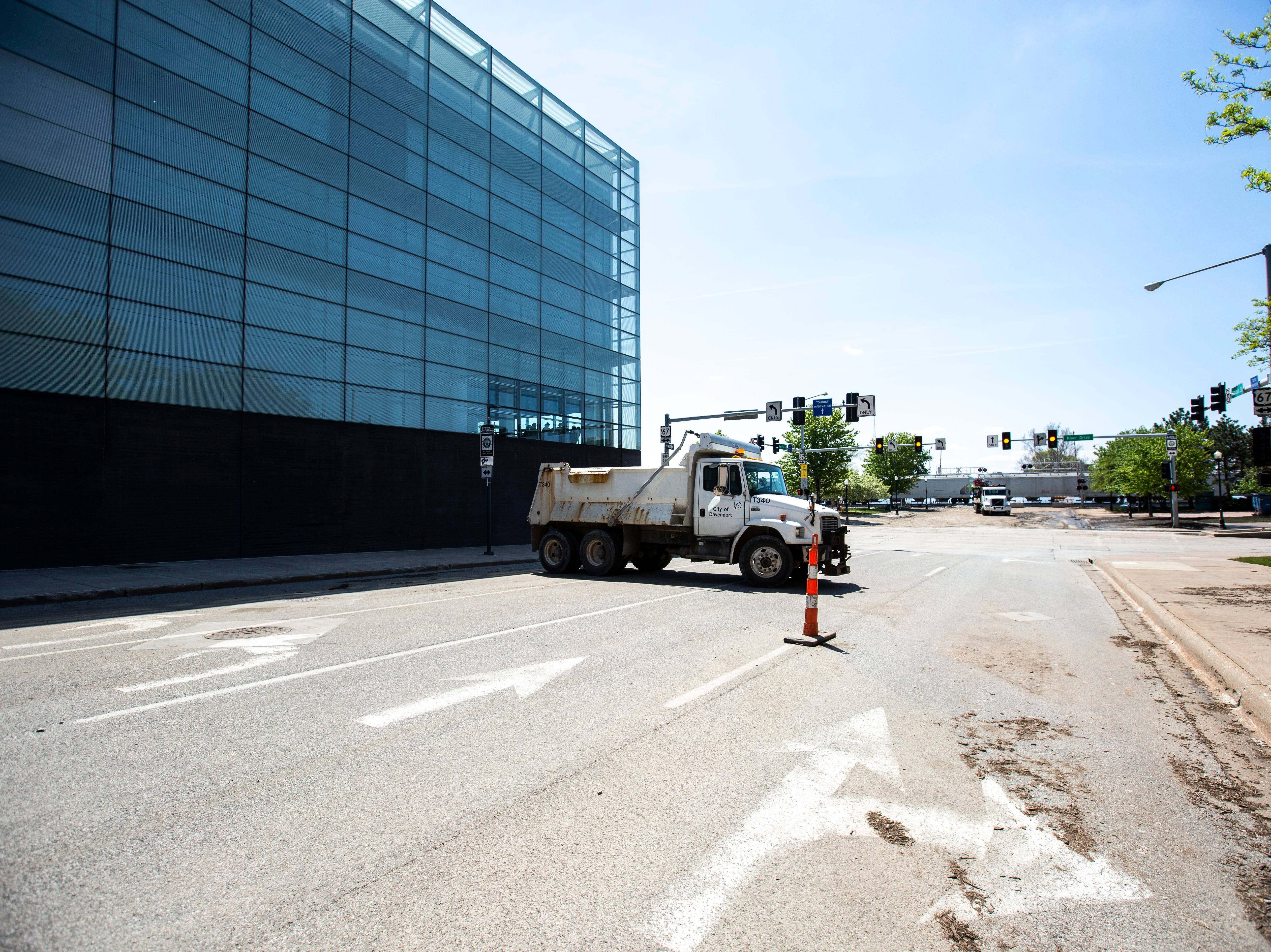 A City of Davenport vehicle parks next to the Figge Art Museum as cleanup begins after floodwaters receded, Wednesday, May 15, 2019, along Harrison Street towards River Drive in downtown Davenport, Iowa.