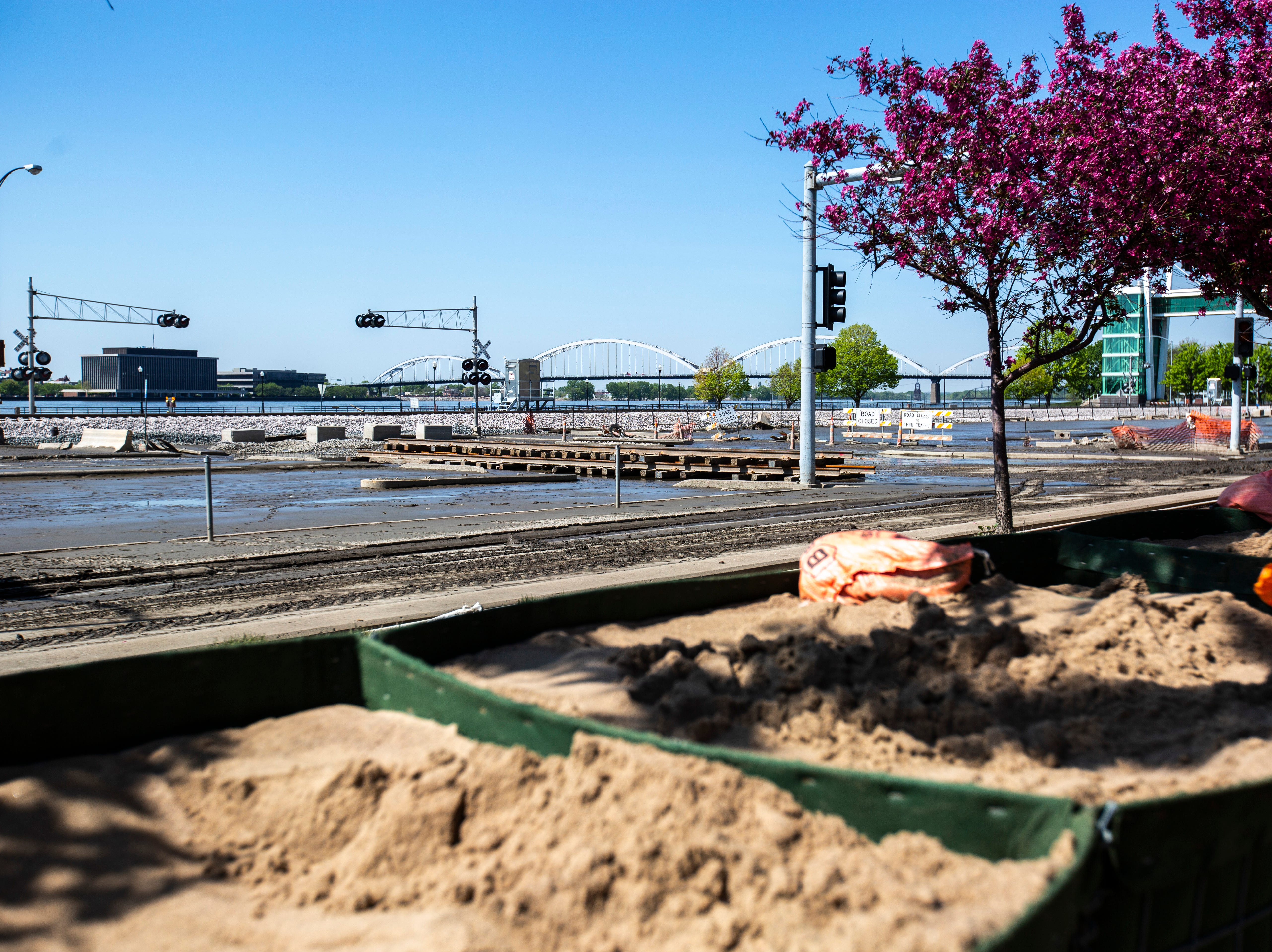Mud and debris remains on the other side of HESCO barriers after floodwaters receded, Wednesday, May 15, 2019, in downtown Davenport, Iowa.