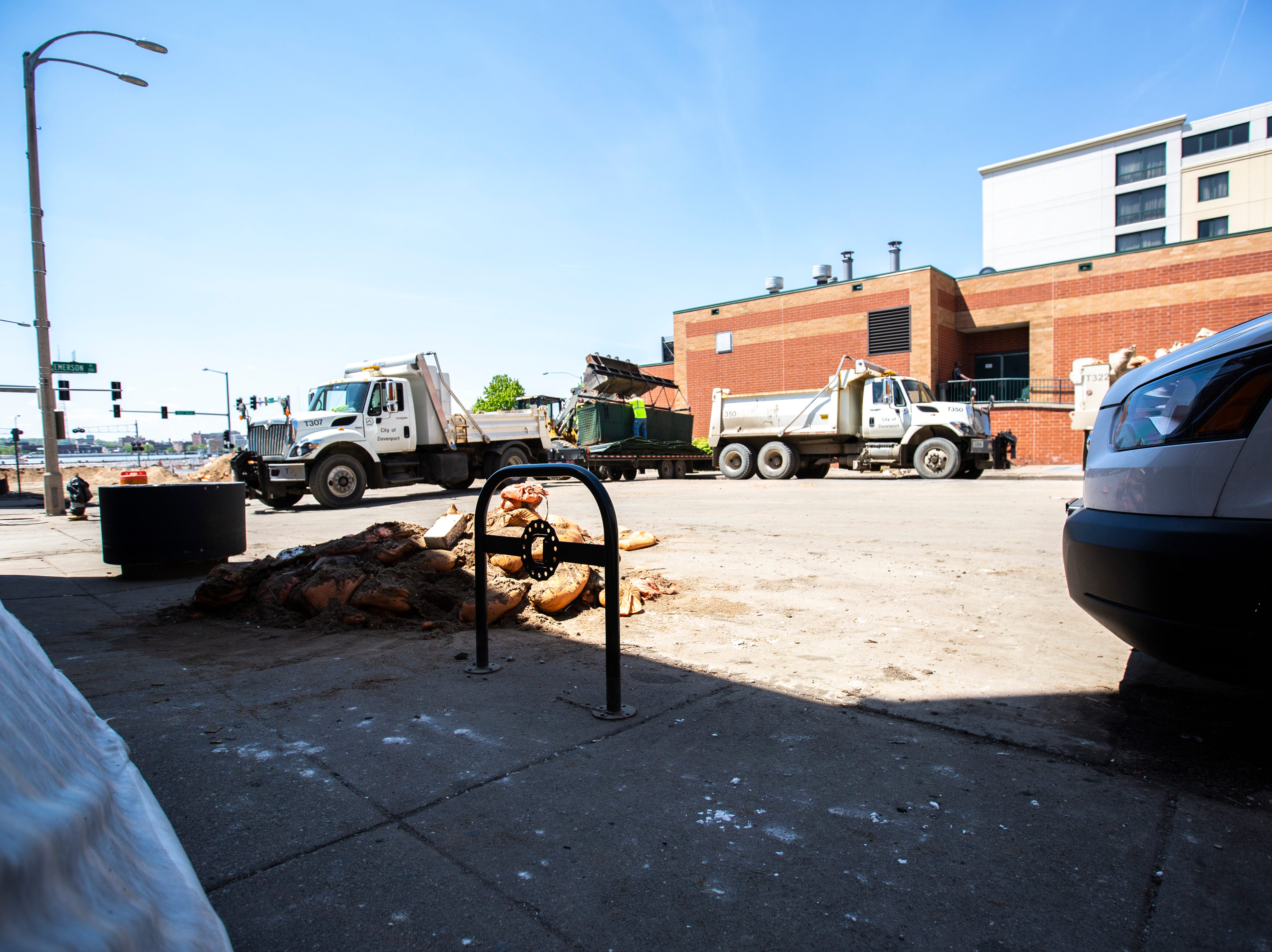 City of Davenport crews work as cleanup begins after floodwaters receded, Wednesday, May 15, 2019, along Perry Street in downtown Davenport, Iowa.