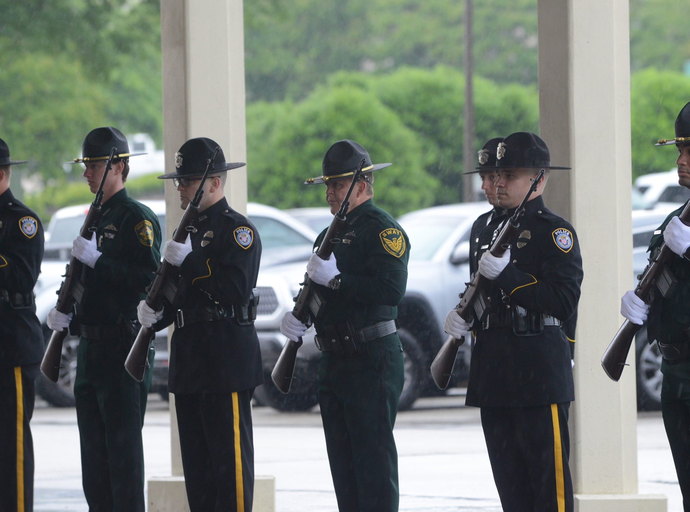 Law enforcement officers stand in formation outside the Carl Perkins Civic Center in Jackson during the National Law Enforcement Memorial Service on Wednesday, May 15, 2019.