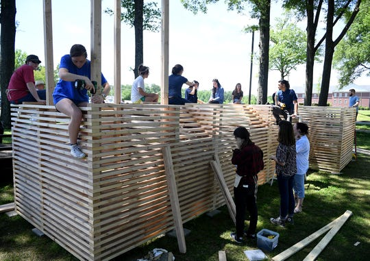 Union University students construct a 3D church sculpture at the school. The sculpture was built to show solidarity for churches burned around the world.