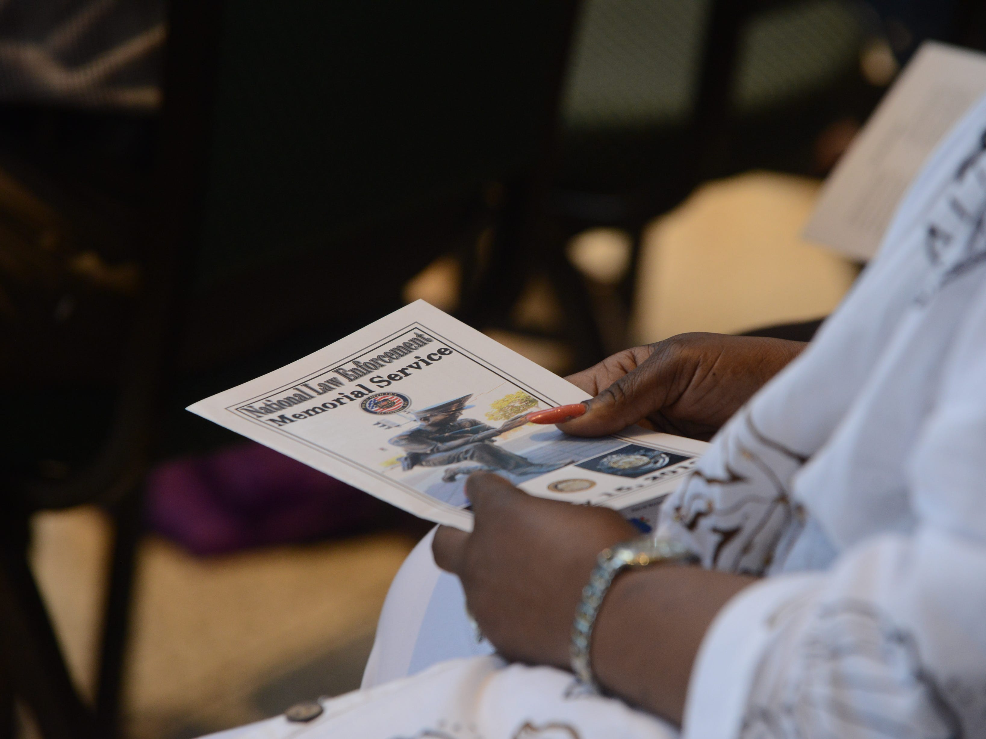 Francis Walker holds the program for the National Law Enforcement Memorial Service at the Carl Perkins Civic Center in Jackson on Wednesday, May 15, 2019. Walker came to honor her niece, Kay Francis Rogers, an officer with the Murfreesboro Police Department who lost her life in 2005.