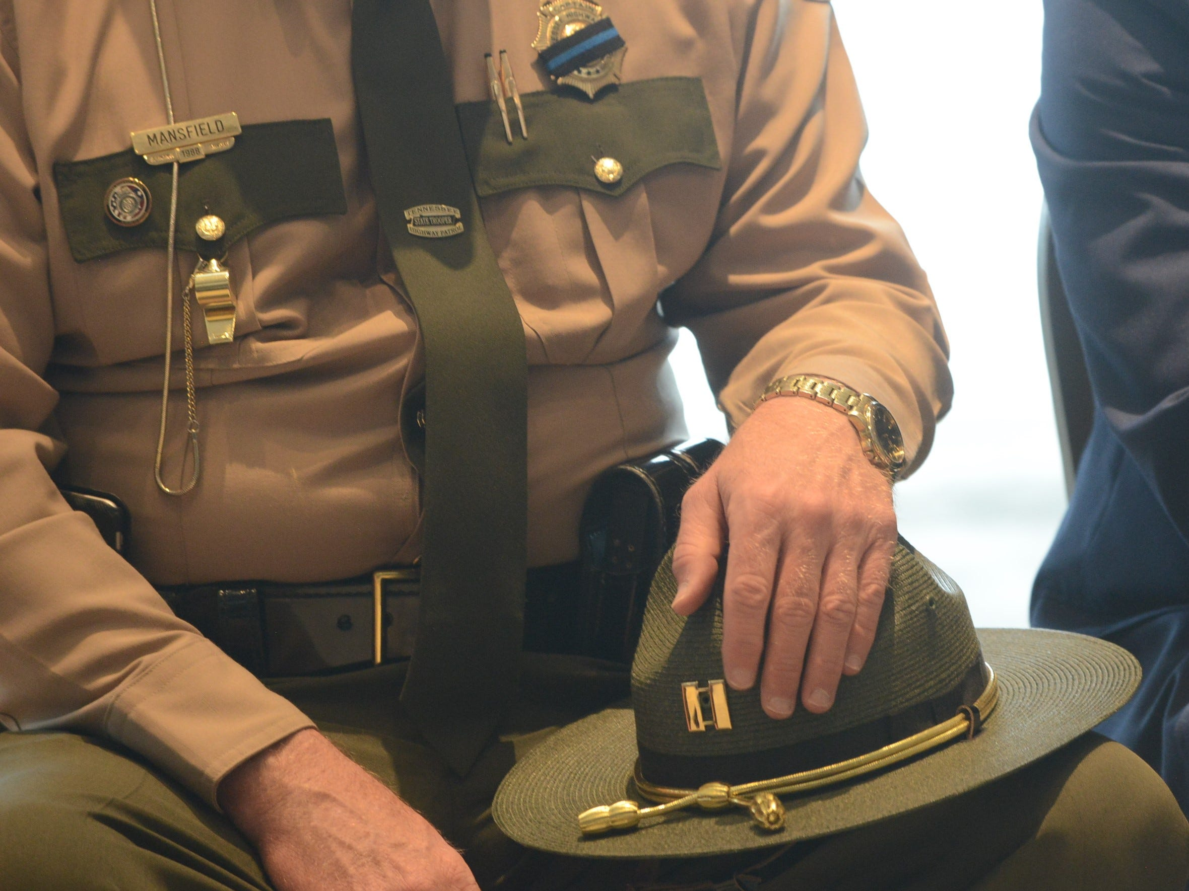 Tennessee Highway Patrol Captain Curtis Mansfield holds his hat on his knee during the National Law Enforcement Memorial Service at the Carl Perkins Civic Center in Jackson on Wednesday, May 15, 2019.