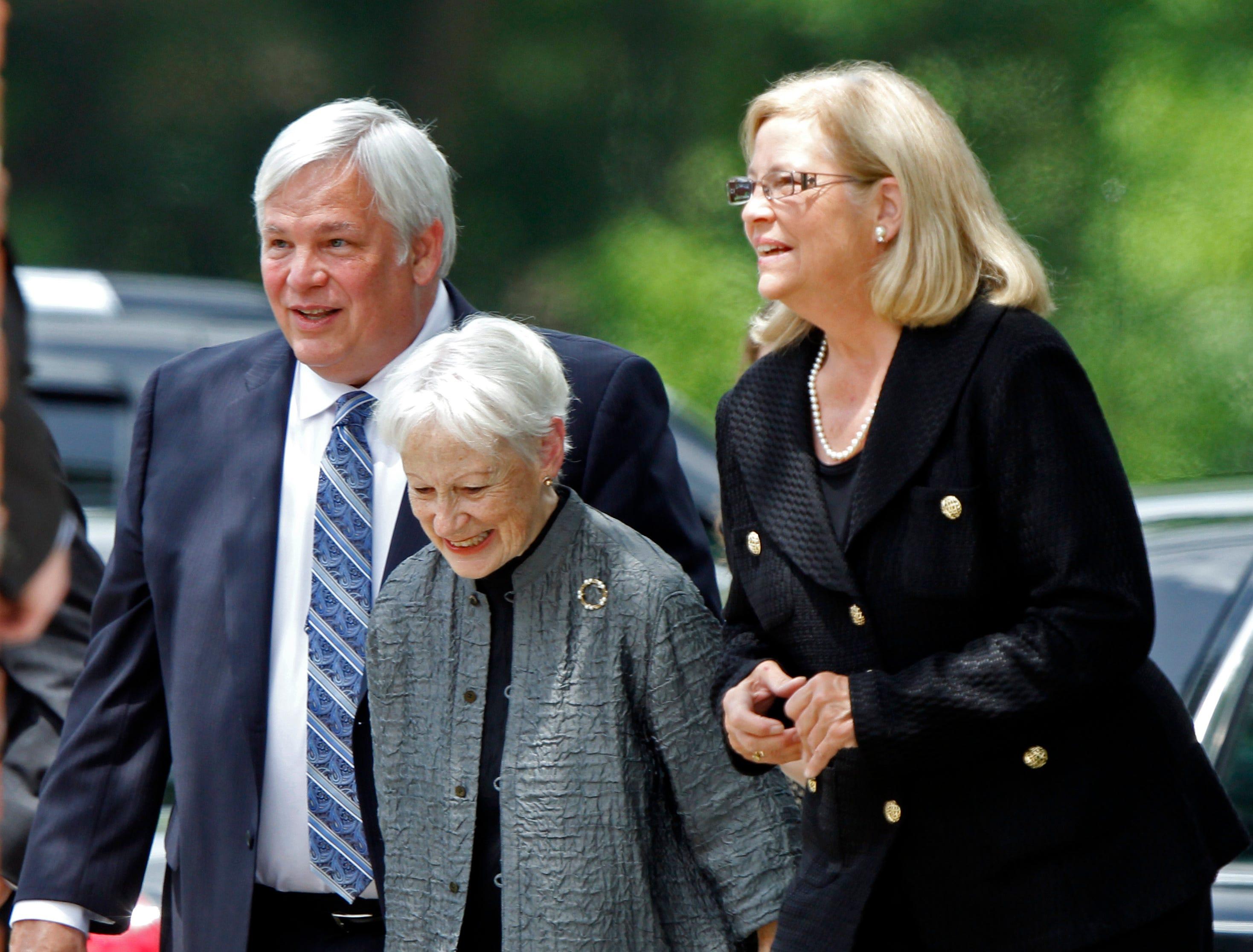 Former Kansas Sen. Nancy Kassebaum, center, widow of former Tennessee Sen. Howard Baker Jr., and Darek Baker and Cynthia Baker arrive for Howard Baker's funeral July 1, 2014, at First Presbyterian Church in Huntsville, Tenn.