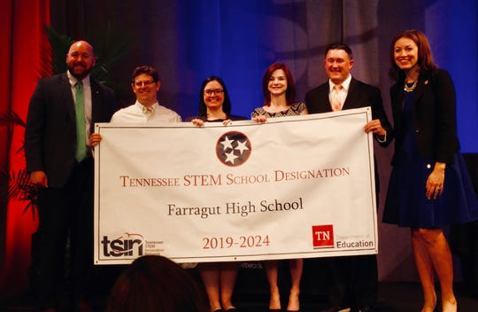 Farragut High School principal Ryan Siebe, second from right, and curriculum principal Candace Greer, third from right, on May 15, 2019. Farragut High School was given a STEM school designation, one of 26 schools in the state.