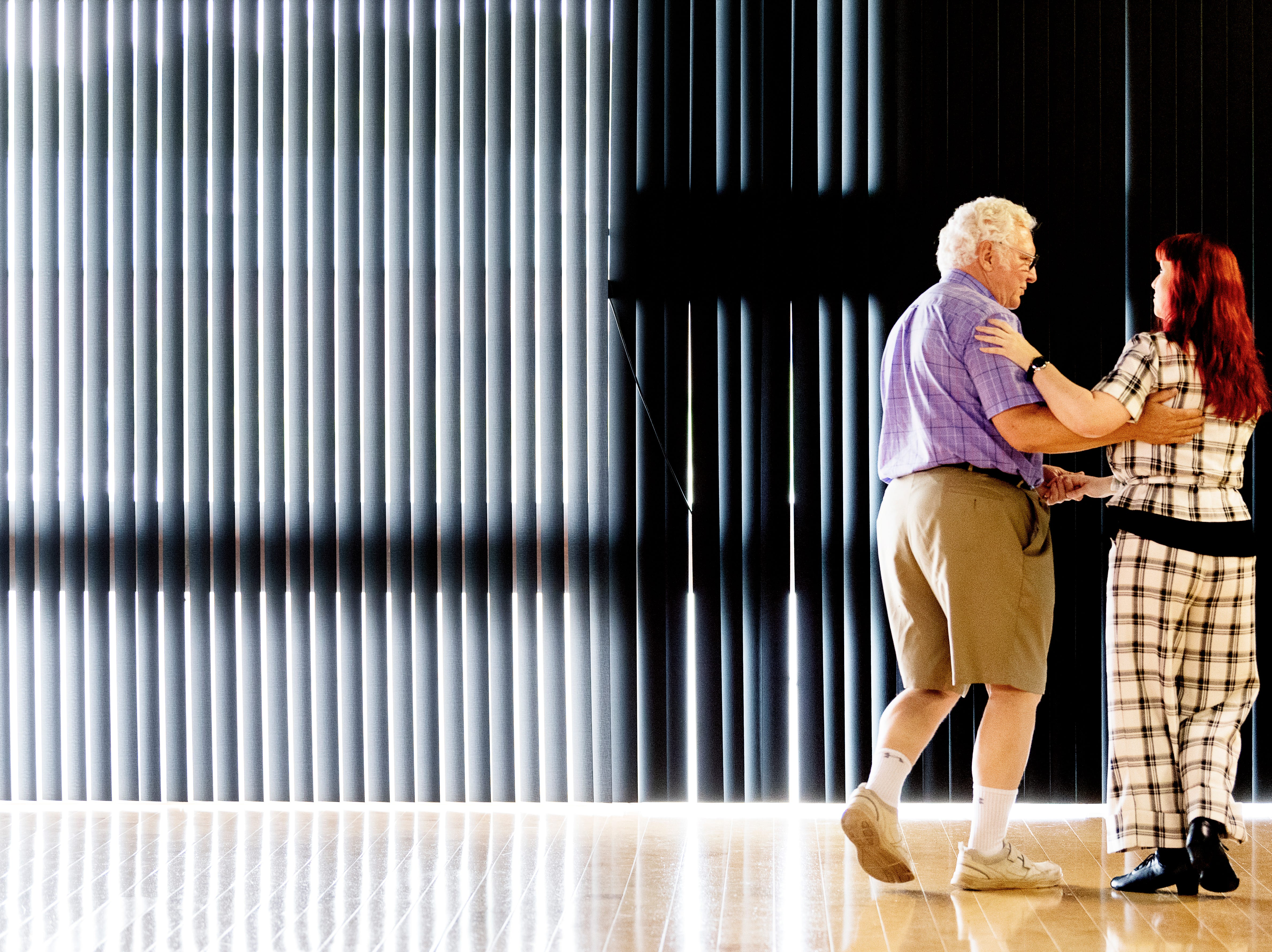 Tony Woodward, of Farragut, dances with his instructor Beth Cofer at Let's Dance Ballroom Dance Studio in Maryville, Tennessee on Thursday, May 9, 2019. Woodward, who lost his wife last year, has been taking dance lessons to stay busy, and, should he meet someone new, have the skills to dance with them, he said.