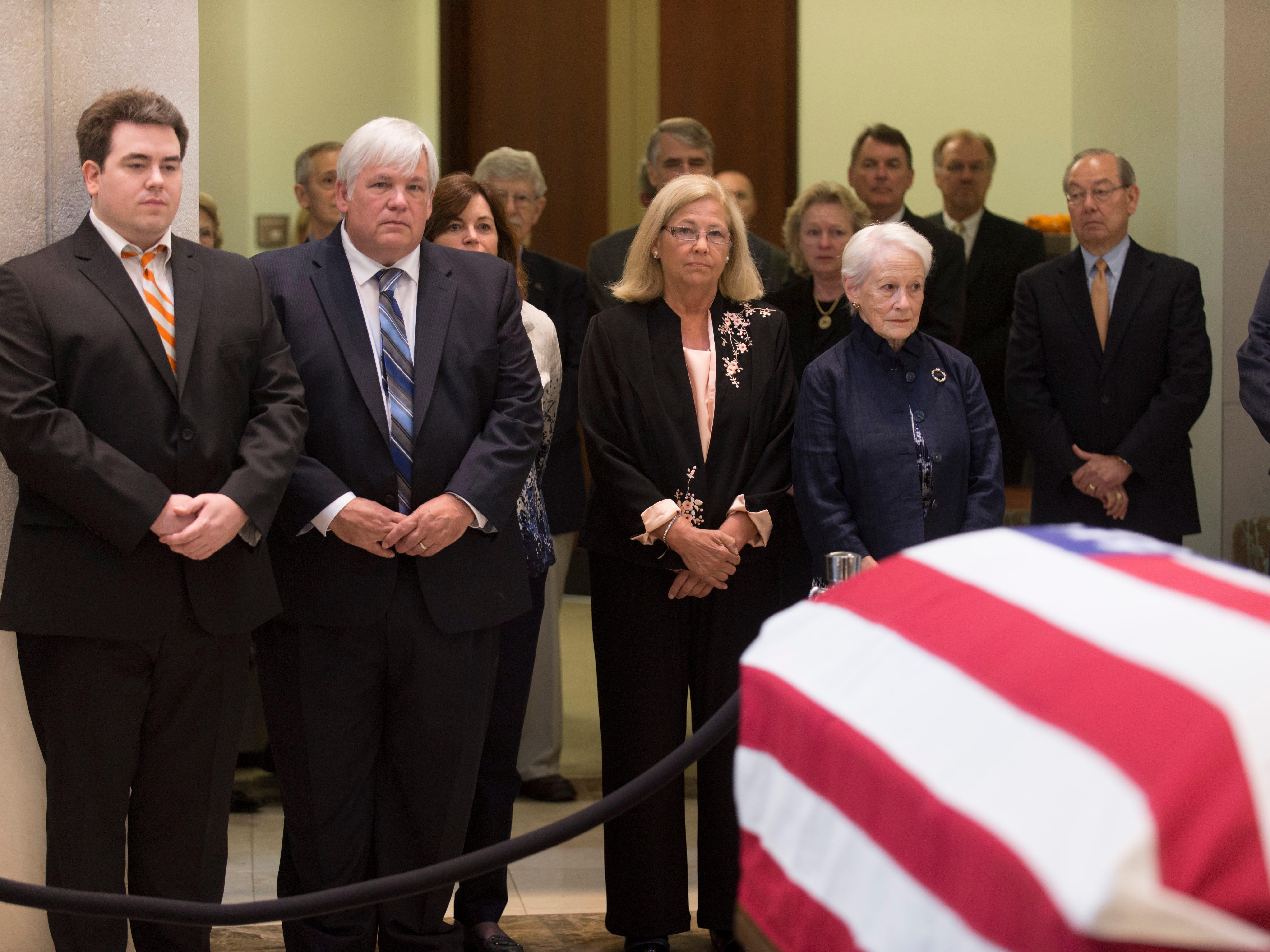 The body of U.S. Sen. Howard H. Baker Jr., lies in repose June 30, 2014, at the Howard H. Baker Jr. Center for Public Policy. Paying their respects are grandson Daniel Baker, left, son Darek Baker, daughter Cissy Baker and former Kansas U.S. Sen. Nancy Kassebaum, Baker's widow.