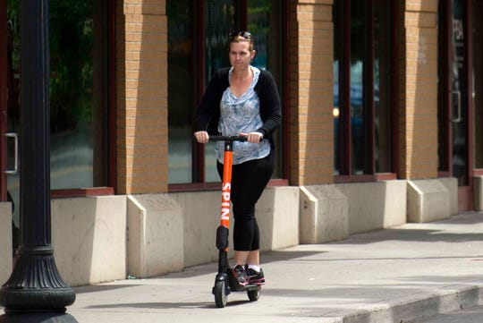 A scooter rider traverses downtown Knoxville, Wednesday, May 15, 2019.