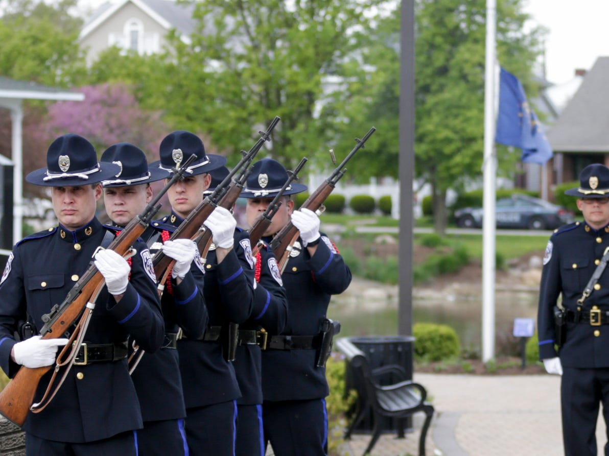 Members of the Lafayette Police honor guard fire a 21-gun salute during the annual police memorial, Wednesday, May 15, 2019, at Columbian Park in Lafayette.