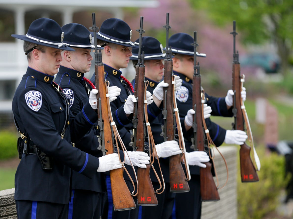 Members of the Lafayette Police honor guard stand at attention during the annual police memorial, Wednesday, May 15, 2019, at Columbian Park in Lafayette.