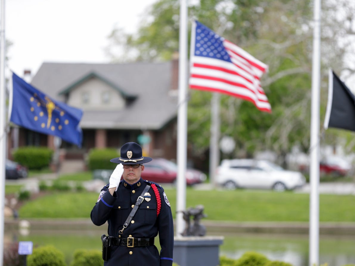 Sgt. Mike Brown salutes during the playing of taps at the annual police memorial, Wednesday, May 15, 2019, at Columbian Park in Lafayette.