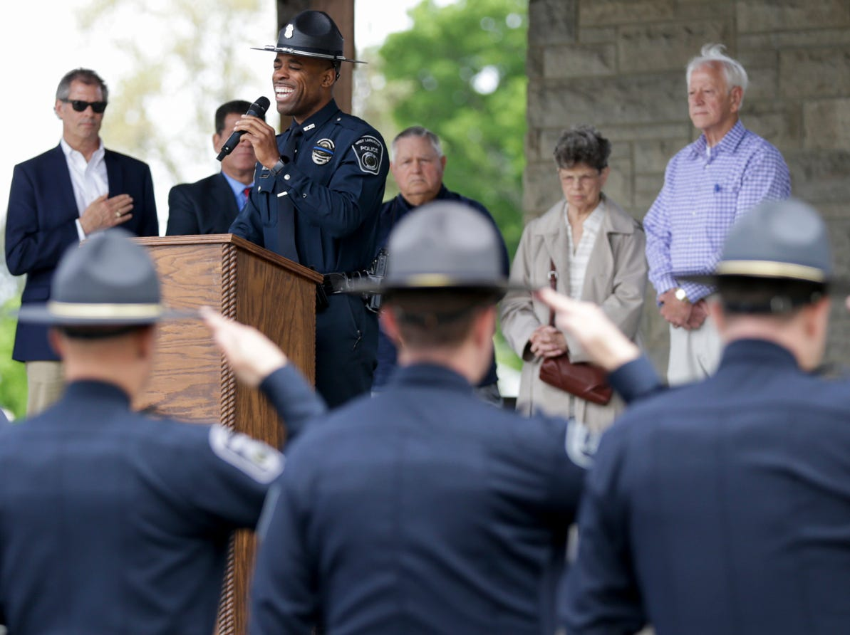 An officer sings the national anthem during the annual police memorial, Wednesday, May 15, 2019, at Columbian Park in Lafayette.