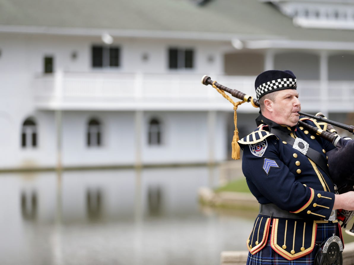 Sgt. John Yestrebsky plays Amazing Grace on the bagpipes during the annual police memorial, Wednesday, May 15, 2019, at Columbian Park in Lafayette.